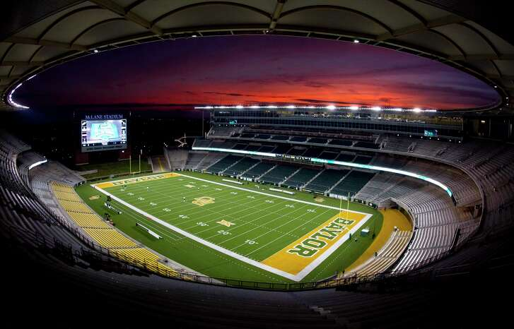 Sun sets on McLane Stadium before The Woodlands' Class 6A Division I regional semifinal game against Austin Bowie Saturday, Nov. 26, 2016, in Waco.