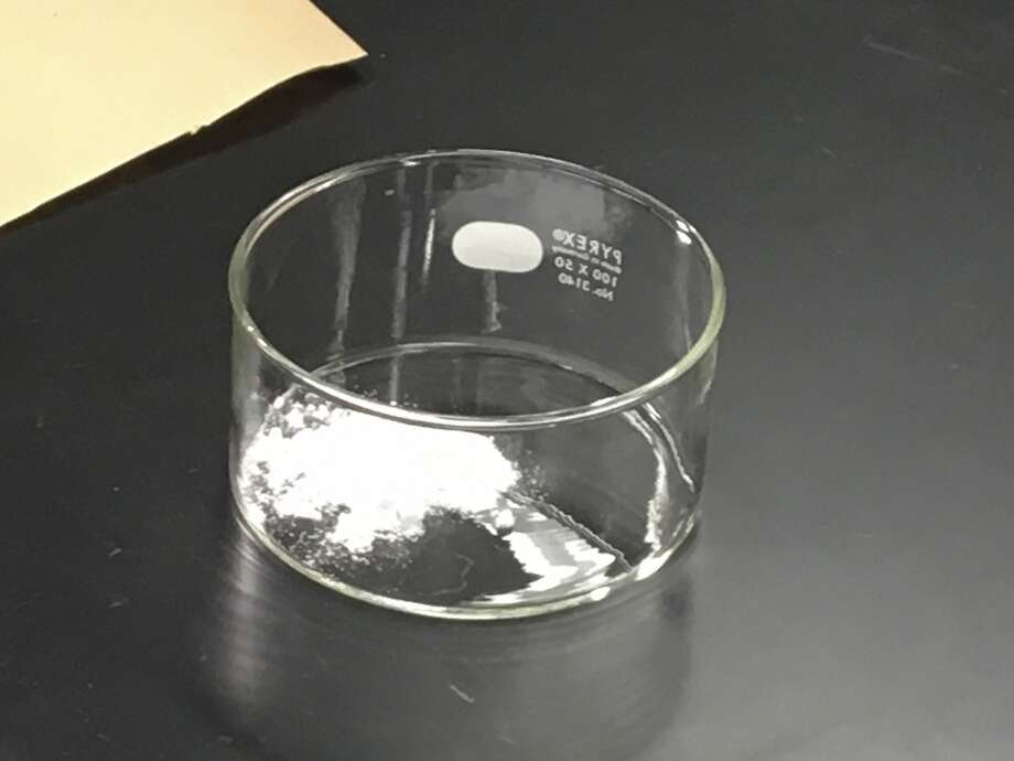FILE - In this photo released by the US Drug Enforcement Agency, DEA, and taken on Oct. 21, 2016, a sample of carfentanil is being analyzed at the DEA's Special Testing and Research Laboratory in Sterling, Va. China is adding the deadly elephant tranquilizer carfentanil and three related synthetic opioids to its list of controlled substances effective March 1, China's National Narcotics Control Commission said Thursday. Photo: Russell Baer, Associated Press