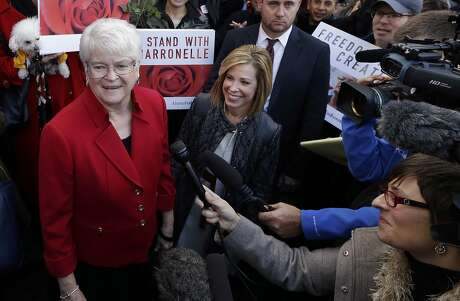 In this Nov. 15, 2016, file photo, Barronelle Stutzman, left, a Richland, Wash., florist who was fined for denying service to a gay couple in 2013, smiles as she is surrounded by supporters after a hearing before Washington's Supreme Court in Bellevue, Wash. The Washington Supreme Court on Thursday, Feb. 16, 2017, has unanimously ruled that Stutzman broke the state's antidiscrimination law.  Stutzman said she was exercising her First Amendment rights, and her lawyers immediately said they would ask the U.S. Supreme Court to overturn the decision. (AP Photo/Elaine Thompson, File) Photo: Elaine Thompson, Associated Press