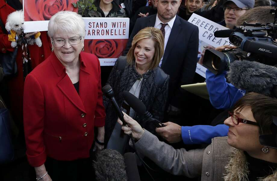 FILE - In this Nov. 15, 2016, file photo, Barronelle Stutzman, left, a Richland, Wash., florist who was fined for denying service to a gay couple in 2013, smiles as she is surrounded by supporters after a hearing before Washington's Supreme Court in Bellevue, Wash. The Washington Supreme Court on Thursday, Feb. 16, 2017, has unanimously ruled that Stutzman broke the state's antidiscrimination law.  Stutzman said she was exercising her First Amendment rights, and her lawyers immediately said they would ask the U.S. Supreme Court to overturn the decision. (AP Photo/Elaine Thompson, File) Photo: Elaine Thompson, Associated Press