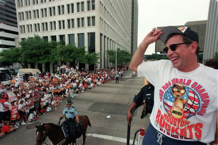 06/16/1995 -  Riding down Jefferson Street, Houston Rockets head coach Rudy Tomjanovich tips his cap to the crowd during the championship parade, 6/16/95, after the Rockets won their second straight NBA Championship. Â Houston Chronicle