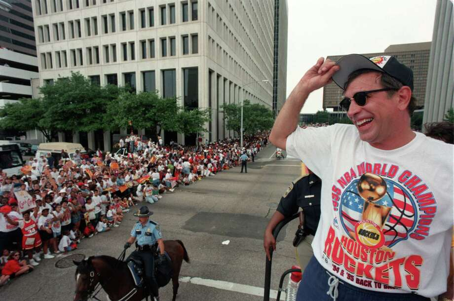 06/16/1995 -  Riding down Jefferson Street, Houston Rockets head coach Rudy Tomjanovich tips his cap to the crowd during the championship parade, 6/16/95, after the Rockets won their second straight NBA Championship. Â Houston Chronicle Photo: Smiley N. Pool, Staff / Houston Chronicle