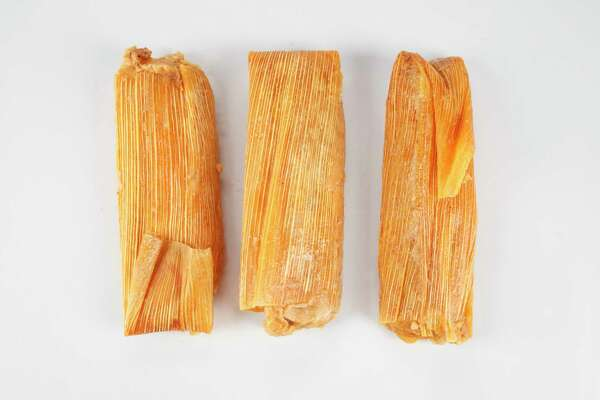 Hand-rolled pork tamales from Alamo Tamales.  Tuesday, Nov. 20, 2012, in Houston. ( Michael Paulsen / Houston Chronicle )