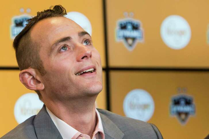 Former Houston Dymano midfielder Brad Davis reacts after signing a one-day contract to retire with the team during a news conference at BBVA Compass Stadium on Thursday, Feb. 16, 2017, in Houston. Davis played for the Dymano from 2006Ð2015, scoring 41 goals in 271 appearances with the MLS team.