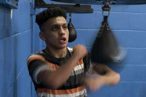 Tommy Santana, a member of the San Fernando Boxing Club, works out on a punching bag at Lincoln Community Center on Feb. 14, 2017, in San Antonio.