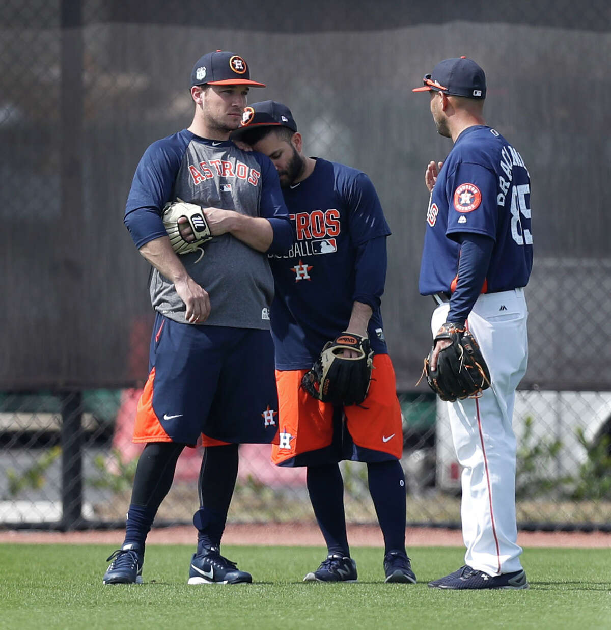 Houston Astros second baseman Jose Altuve leans against Alex Bregman as they chatted with bullpen catcher Javier Bracamonte while they worked out with the other position players who came to camp early during spring training at The Ballpark of the Palm Beaches, in West Palm Beach, Florida, Thursday, February 16, 2017.