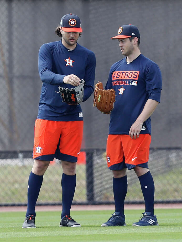 Houston Astros Preston Tucker and Jake Marisnick talk about gloves as they worked out with the other position players who came to camp early during spring training at The Ballpark of the Palm Beaches, in West Palm Beach, Florida, Thursday, February 16, 2017. Photo: Karen Warren, Houston Chronicle / 2017 Houston Chronicle