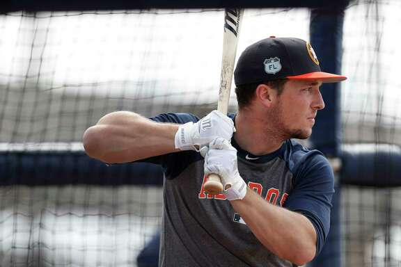 Houston Astros third baseman Alex Bregman bats as he worked out with the other position players who came to camp early during spring training at The Ballpark of the Palm Beaches, in West Palm Beach, Florida, Thursday, February 16, 2017.