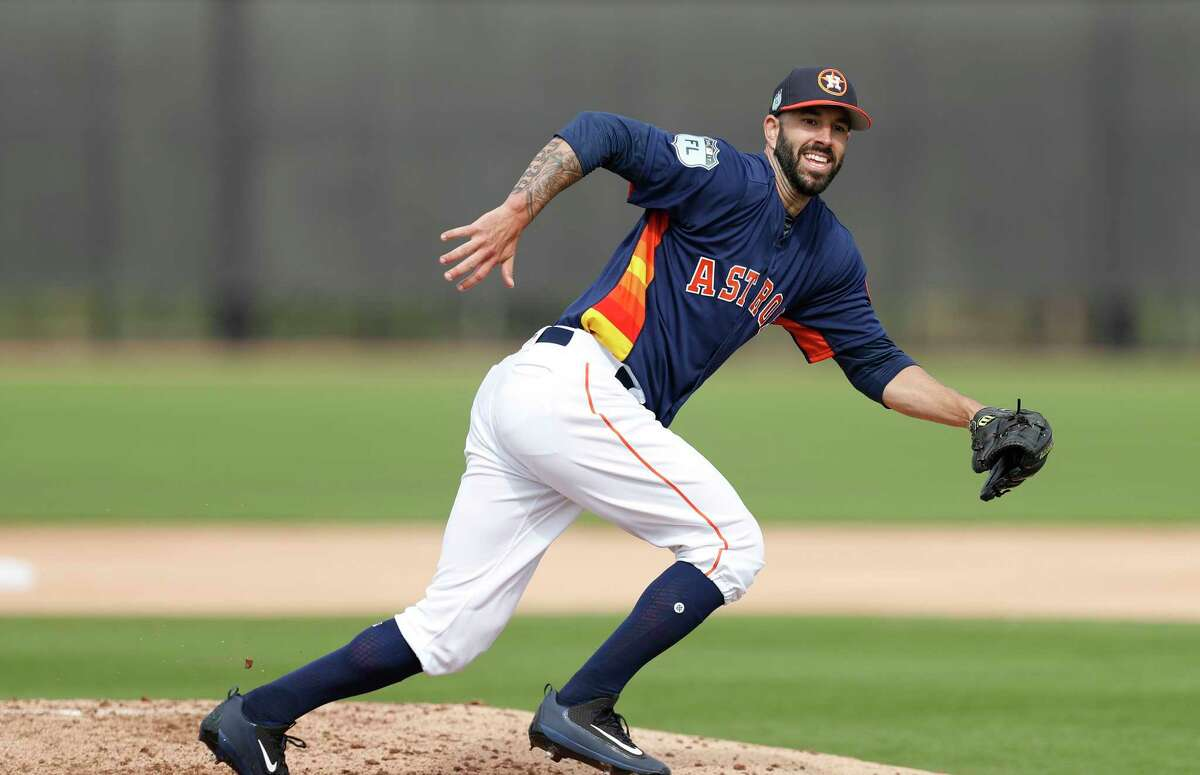 Houston Astros starting pitcher Mike Fiers chases a ball during spring training at The Ballpark of the Palm Beaches, in West Palm Beach, Florida, Thursday, February 16, 2017.