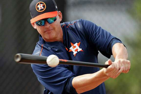 Houston Astros manager A.J. Hinch hits balls to pitchers during a drill at spring training at The Ballpark of the Palm Beaches, in West Palm Beach, Florida, Thursday, February 16, 2017.