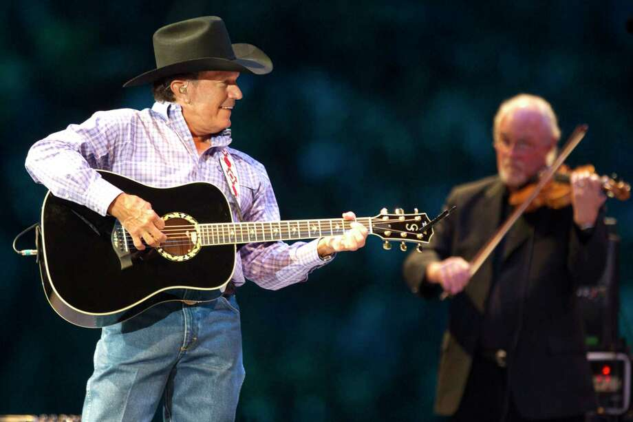 George Strait performs his set at Reliant Stadium during the final concert at the Houston Livestock Show and Rodeo Sunday, March 17, 2013, in Houston. ( Brett Coomer / Houston Chronicle ) Photo: Brett Coomer, Staff / © 2013 Houston Chronicle