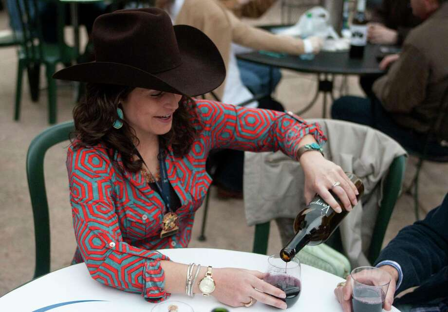 Mandy Jackson pours a glass of wine at the Champion Wine Garden. Photo: J. Patric Schneider, Freelance / © 2014 Houston Chronicle