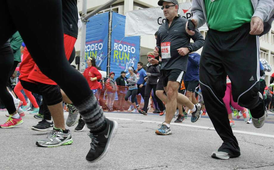 Runners participate in the ConocoPhillips Rodeo Run. Photo: Melissa Phillip, Staff / © 2014  Houston Chronicle