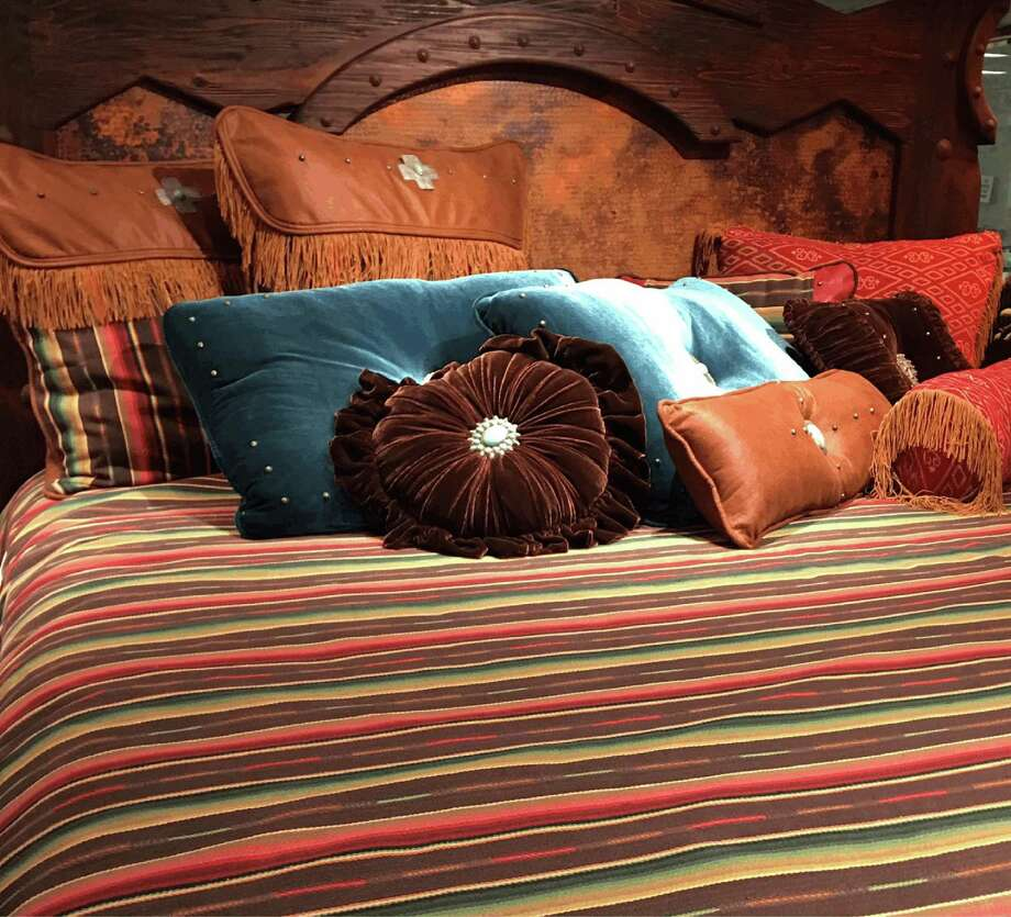 Rustic Elegance of Kerrville will sell home decor items such as these pillows on the club level of NRG Stadium during the 2017 Houston Livestock Show and Rodeo. Photo: Rustic Elegance