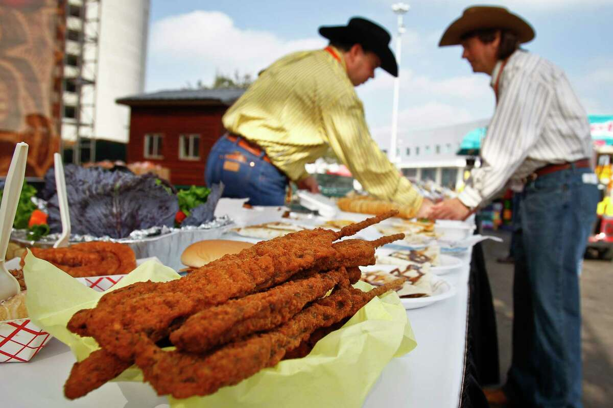 Fried beef kerky from Yoakum Packing Company sits on the table as Jay Justilian (left) and John Kaplan (all with the Commercial Exhibits Committee) organize entered food during the 3rd Annual Gold Buckle Foodie Awards at the Houston Livestock Show and Rodeo.