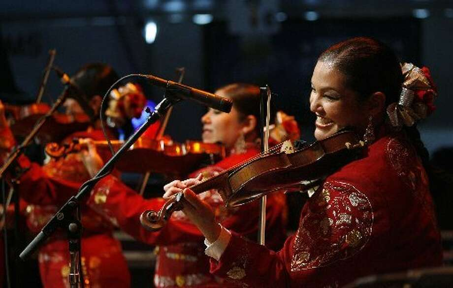 An all-female mariachi at the Mariachi Invitational Semifinals on Go Tejano Day at the Houston Livestock Show and Rodeo. Photo: Mayra Beltran: