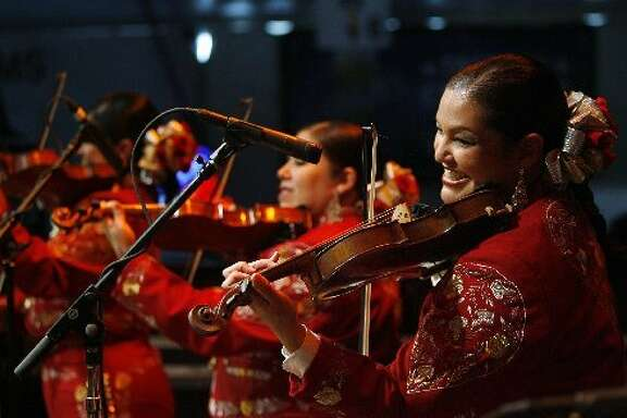 An all-female mariachi at the Mariachi Invitational Semifinals on Go Tejano Day at the Houston Livestock Show and Rodeo.