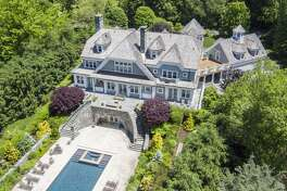 This 14 room colonial on Indian Field Road in Greenwich, Conn. is great place to entertain, and it also has an air of seclusion with its private beach access. The home was built in 2004, and it's been scrupulously maintained by its owner, Wynn Plaut.
