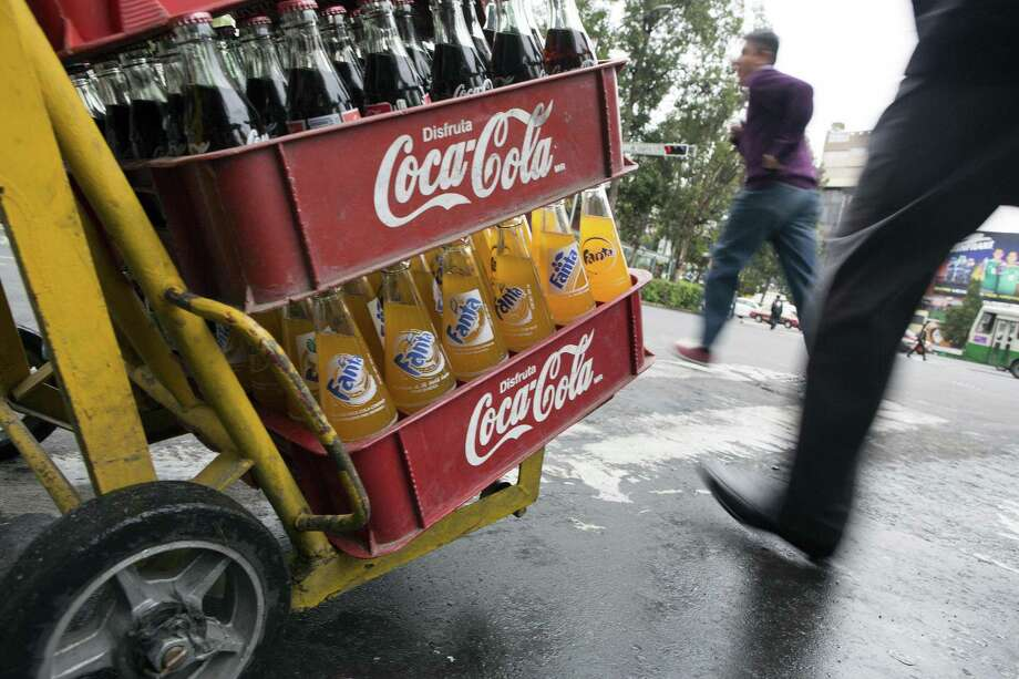 "Regular fountain soft drink:Was $5 — Now $3Bottled 20 oz. soft drink:Was $5 — Now $4Souvenir ""Texas"" soft drink: