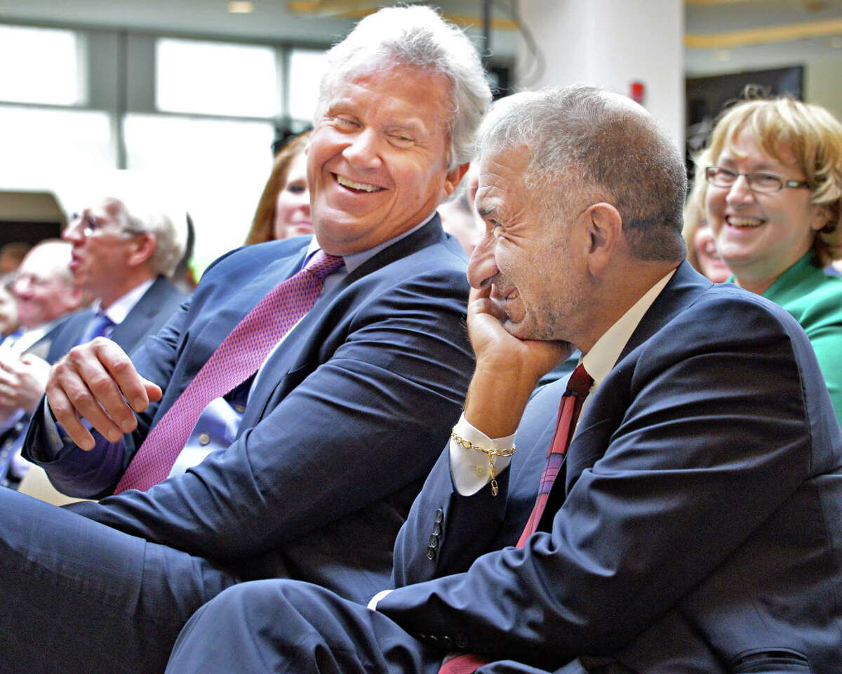 GE CEO Jeff Immelt, left, and Albany Nanocollege CEO Alain Kaloyeros share a laugh during the announcement of a new $500 million power electronics manufacturing consortium in the Capital Region at GE Global Research Tuesday July 15, 2014, in Niskayuna, NY. (John Carl D'Annibale / Times Union)