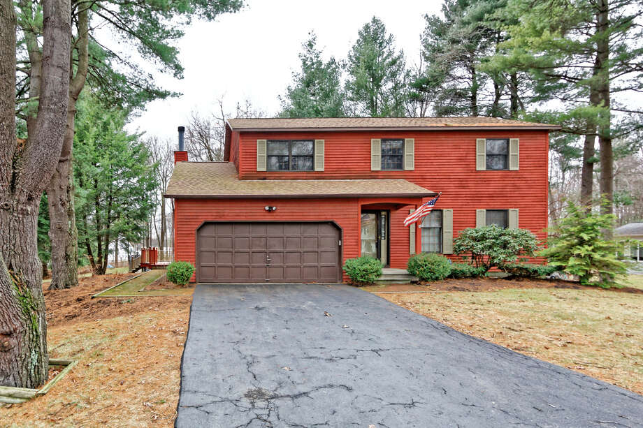 9 Maryanne Drive Clifton Park  The bright-colored cedar siding makes this 1,935 square-foot house grab your attention. Inside, it features a wraparound porch, large eat-in kitchen, four bedrooms and 2 1 2 bathrooms, plus a full basement. (Anthony Gucciardo)