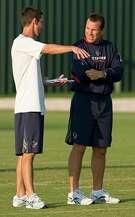 Houston Texans offensive coordinator Kyle Shanahan, left, and head coach Gary Kubiak talk during an NFL football training camp workout Thursday, Aug. 13, 2009, Houston.  ( Brett Coomer / Chronicle )