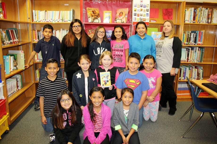 Highland students participating in the vote for the Texas Bluebonnet Book Award included Thalia Guerra (seated, left), Addison Barrientos, Stormyee Rey, Julius Zapata (kneeling, left), Senaida Valdez, Sarah Myrick, Kevin Cardiel, Lindsey Mendoza, Vincent Suarez (standing, left), S'Nida Guerra, Sabrie Rodriguez, Sarah Navares and Aubrey Hernandez. Also pictured is Highland library assistant Typhany Jones (standing, right).