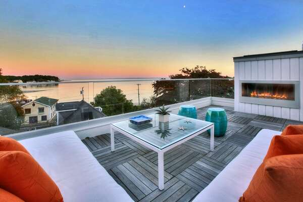 Overlooking Compo Beach, the house at 33 Sherwood Drive in Westport was designed by noted architect Peter Cadoux, who designed the Levitt Pavilion, along with other properties. Its more unique features include a panoramic roof deck with an outdoor fireplace, a glass ceiling shower and kitchen cabinets that fold up with a gentle touch.