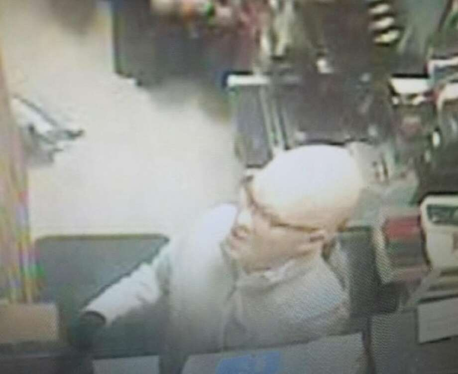 Surveillance footage from the robbery of a Pacifica Safeway on Wednesday appears to show the robber wearing a full-head mask. Photo: Courtesy Pacifica Police Department, Pacifica Police Department