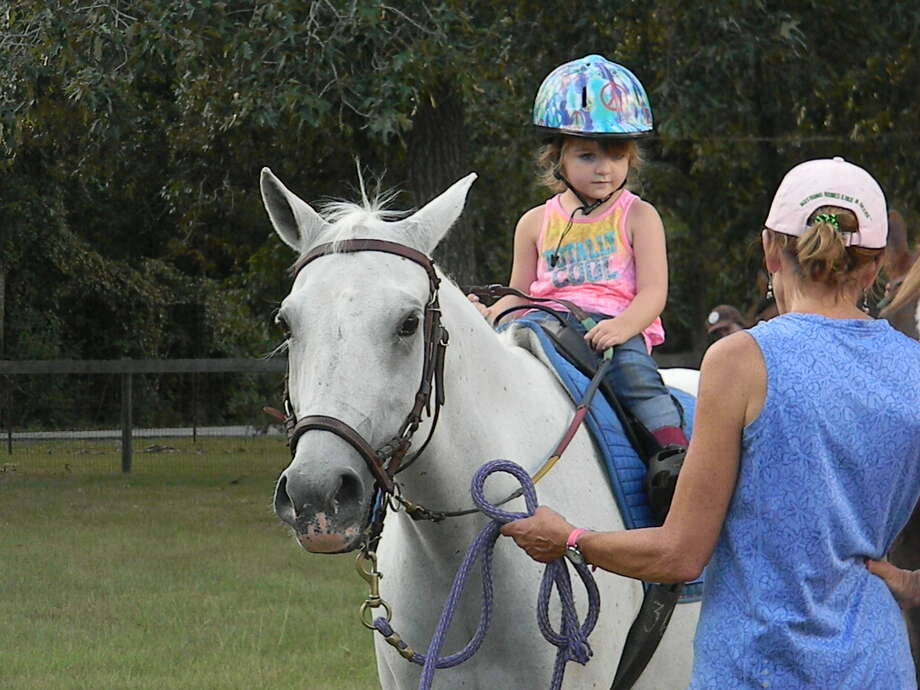 Skyler Lindemann rides a horse at SIRE. Inspiring Hands, a Tomball-based nonprofit organization, is looking to      provide individuals with special needs the opportunity to attend camp and      therapeutic horse ridership programs. Photo: N/a