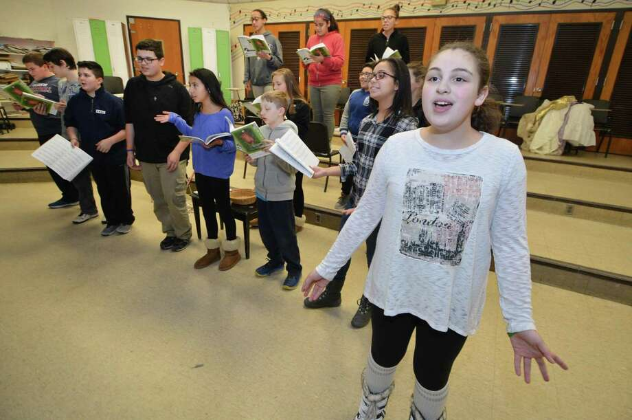 Samantha Przybisiki as the narator, sings along while rehearsing with the cast of Into the Woods Jr. at Ponus Ridge Middle School on Wednesday february 15, 2017 in Norwalk Conn. They purchased the rights for this years scheduled production of Into the Woods, Jr, with their last dollars and began rehearsal with the 20-member cast and 20-member crew in hopes the Norwalk community will help out financially in order to preserve the more than a decade-long tradition. Photo: Alex Von Kleydorff / Hearst Connecticut Media / Connecticut Post