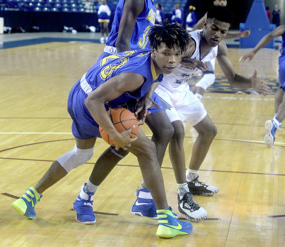 Central's Byron Arceneaux looks to get hold of the loose ball against Ozen's Derrion Jones during their final district game of the season Tuesday night at Ford Park. Photo taken Tuesday, February 14, 2017 Kim Brent/The Enterprise Photo: Kim Brent