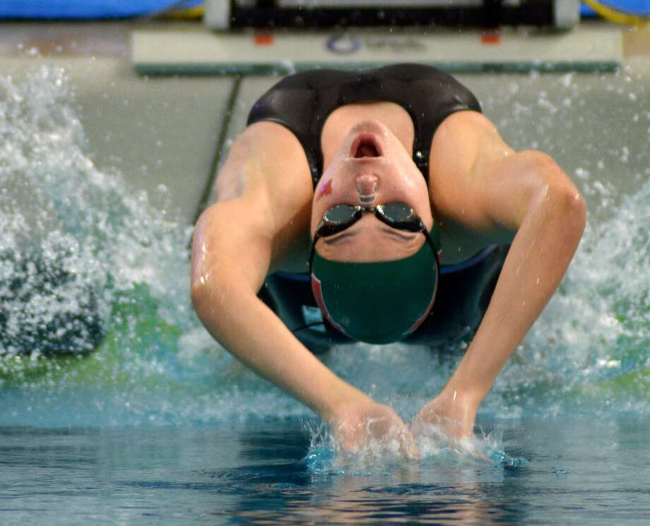 The Woodlands sophomore Lucie Nordmann leaves the blocks in her heat of the Girls 100 Yard Backstroke during the Conference 6A prelims at the 2016 UIL State Swimming and Diving Championships at the Texas Swim Center in Austin on Friday, Feb. 19, 2016. (Photo by Jerry Baker/Freelance) Photo: Jerry Baker, Freelance