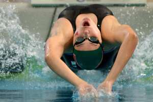 The Woodlands sophomore Lucie Nordmann leaves the blocks in her heat of the Girls 100 Yard Backstroke during the Conference 6A prelims at the 2016 UIL State Swimming and Diving Championships at the Texas Swim Center in Austin on Friday, Feb. 19, 2016. (Photo by Jerry Baker/Freelance)