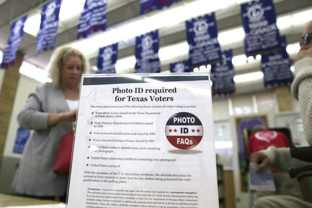A sign in March last year tells voters of voter ID requirements before participating in the primary election at Sherrod Elementary school in Arlington, Texas. The Supreme Court has declined to hear an appeal by Texas on a successful challenge to the law, so it is not in effect anymore. Texas should leave it that way.