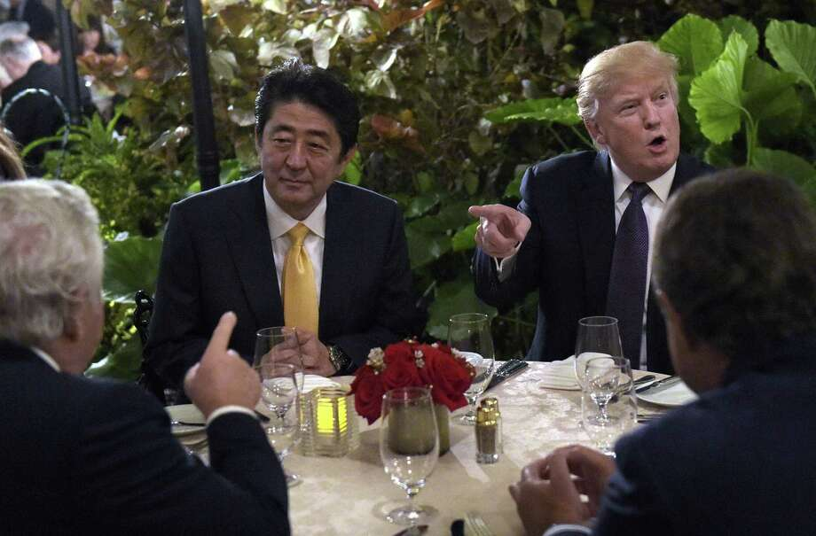 President Donald Trump dines with Japanese Prime Minister Shinzo Abe at his Mar-a-Lago resort in Palm Beach, Fla. A reader wonders whether the president threatened national security by meeting with the Japanese leader in public. Photo: Susan Walsh /Associated Press / Copyright 2017 The Associated Press. All rights reserved.