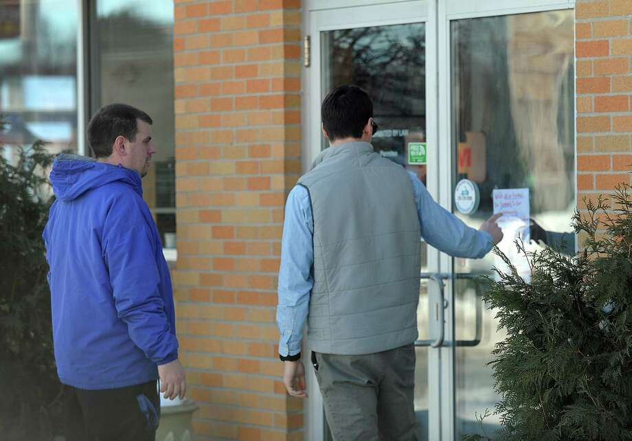 Jason Vansickle, left, and Barry Dobs, both of Danbury, looking for a place to eat lunch Thursday, find Elmer's Diner closed. Elmer's Diner in Danbury is closed Thursday, Feb. 16, 2017, in solidarity with other immigrant-owned businesses in the city. Photo: Carol Kaliff / Hearst Connecticut Media / The News-Times