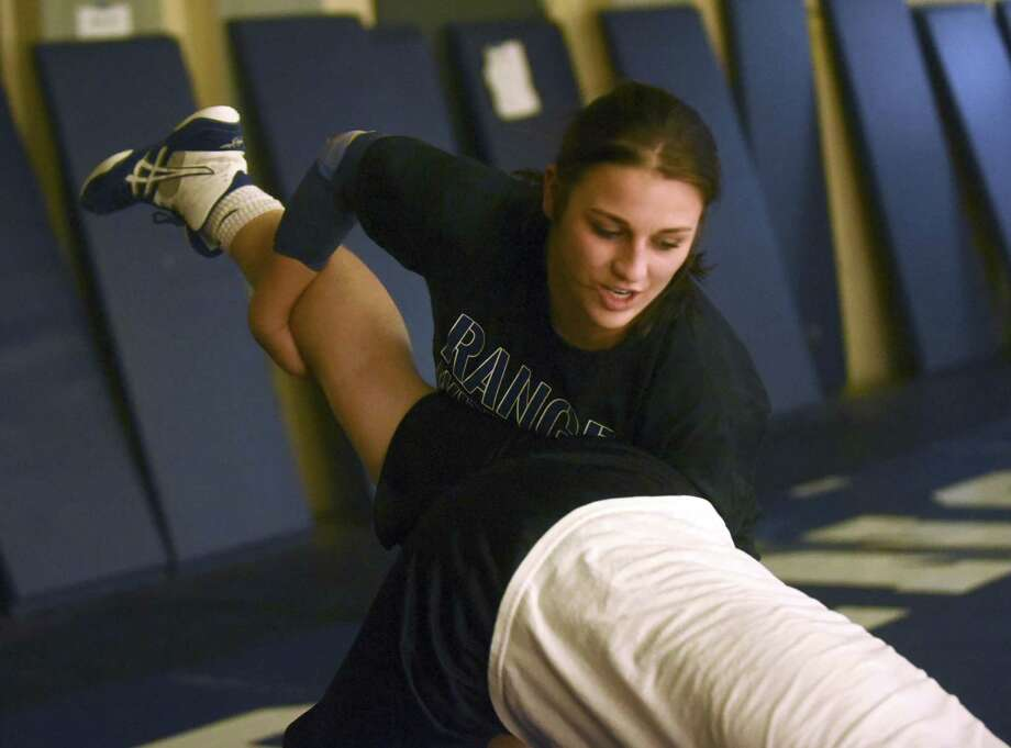 Smithson Valley's District 14-6A girls 165-pound weight class wrestling champion Taylor Mooney works out on Feb. 15, 2017. Photo: Billy Calzada /San Antonio Express-News / San Antonio Express-News