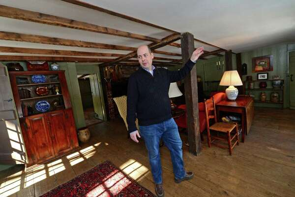 John Harrington leads a tour Thursday, February 16, 2017, of the Enos-Kellog House he purchased a decade ago and who has spent that time restoring the historic property at 210 Ponus Ave. in Norwalk, Conn.