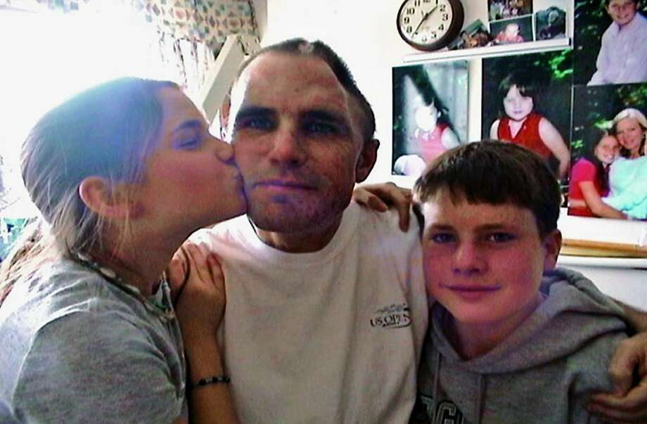 Woodruff with two of his children shortly after he awoke from a coma after he suffered severe shrapnel wounds in 2006. Photo: HO, SFC