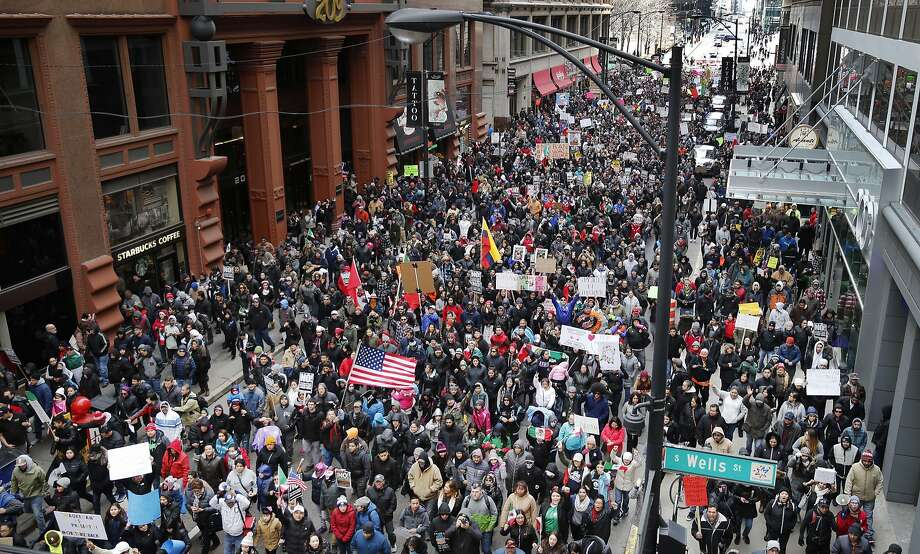 More than a thousand protesters participate in a march aimed squarely at President Donald Trump's efforts to crack down on immigration Thursday, Feb. 16, 2017, in Chicago. Immigrants around the country have been staying home from work and school today, hoping to demonstrate their importance to America's economy and its way of life.  Photo: Charles Rex Arbogast, Associated Press