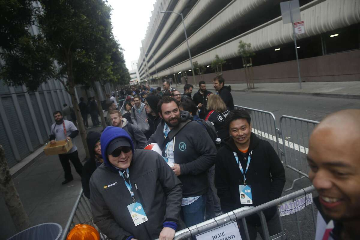 Jacob Eberhart (left) of Houston, Texas and vice president of communications Canary, stands in line outside Moscone West with others before the Google I/O 2015 keynote on Thursday, May 28, 2015 in San Francisco, Calif.