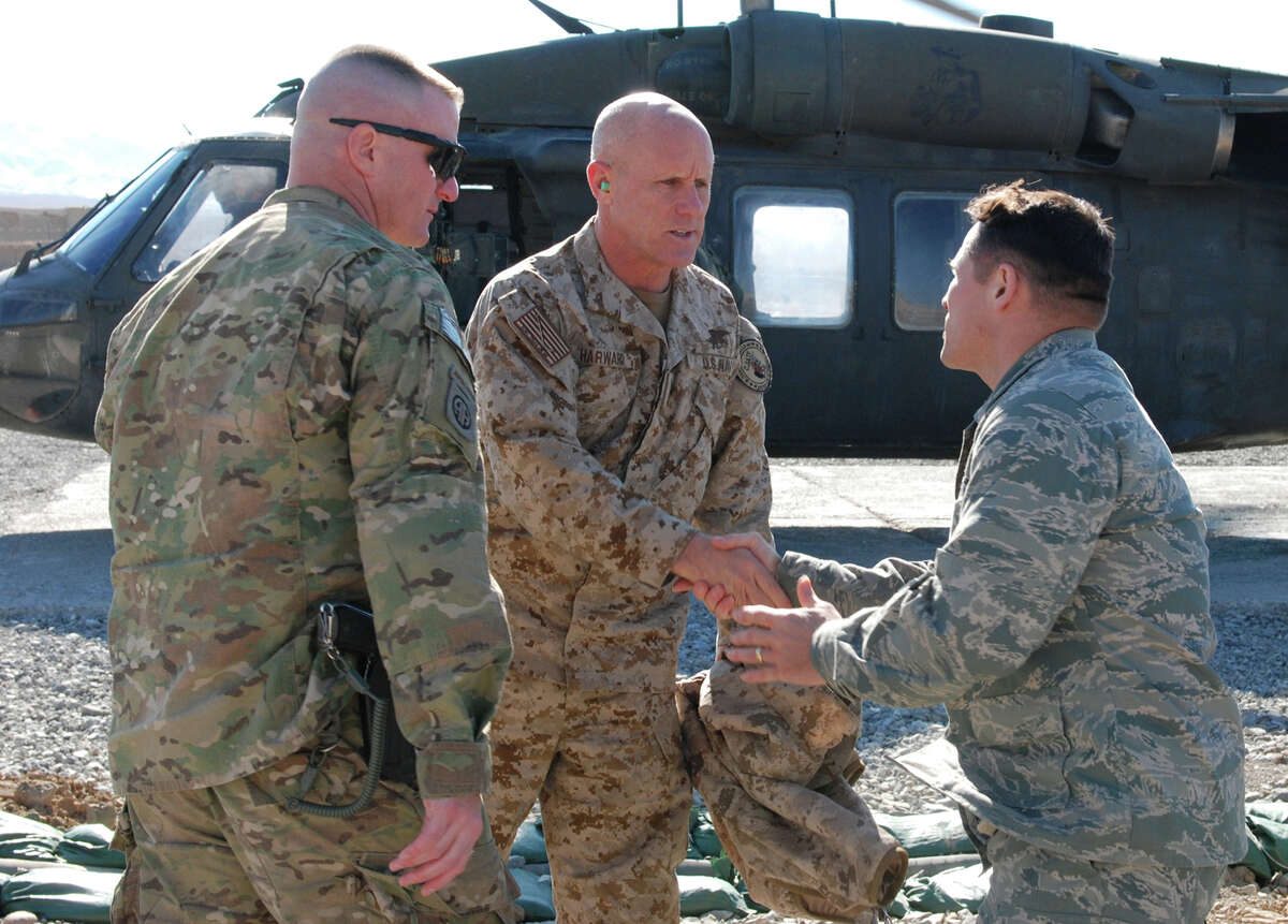 U.S. Navy Vice Adm. Robert Harward, commander of Combined Joint Interagency Task Force 435, shakes hands with U.S. Air Force Lt. Col. Marchal Magee of Issaquah, Wash., commander of the Paktya Provincial Reconstruction Team, while U.S. Army Lt. Col. Steve Boesen, commander of Task Force Lethal from Ankeny, Iowa, waits to greet Harward. Harward visited Forward Operating Base Gardez, Afghanistan, Jan. 12 to talk with Afghan and U.S. commanders about how Afghans are implementing the rule of law.