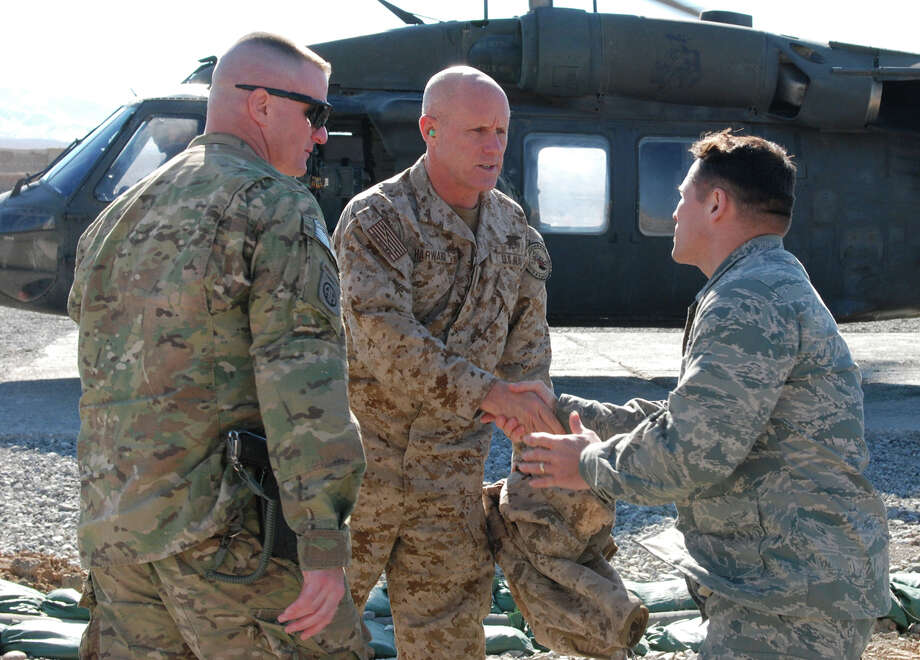 U.S. Navy Vice Adm. Robert Harward, commander of Combined Joint Interagency Task Force 435, shakes hands with U.S. Air Force Lt. Col. Marchal Magee of Issaquah, Wash., commander of the Paktya Provincial Reconstruction Team, while U.S. Army Lt. Col. Steve Boesen, commander of Task Force Lethal from Ankeny, Iowa, waits to greet Harward. Harward visited Forward Operating Base Gardez, Afghanistan, Jan. 12 to talk with Afghan and U.S. commanders about how Afghans are implementing the rule of law. Photo: U.S. Department Of Defense