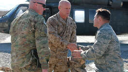 FILE - U.S. Navy Vice Adm. Robert Harward, commander of Combined Joint Interagency Task Force 435, shakes hands with U.S. Air Force Lt. Col. Marchal Magee of Issaquah, Wash., commander of the Paktya Provincial Reconstruction Team, while U.S. Army Lt. Col. Steve Boesen, commander of Task Force Lethal from Ankeny, Iowa, waits to greet Harward. Harward visited Forward Operating Base Gardez, Afghanistan, Jan. 12 to talk with Afghan and U.S. commanders about how Afghans are implementing the rule of law. (Photo by U.S. Army Sgt. John P Sklaney III, 2-45th Agribusiness Development Team)