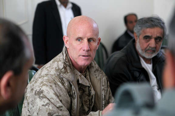 FILE - Vice Adm. Robert S. Harward, commanding officer of Combined Joint Interagency Task Force 435, speaks to an Afghan official during his visit to Zaranj, Afghanistan, Jan 6. The visit consisted of a tour of a provincial prison, the Iran/Afghanistan border crossing and an airfield assessment.