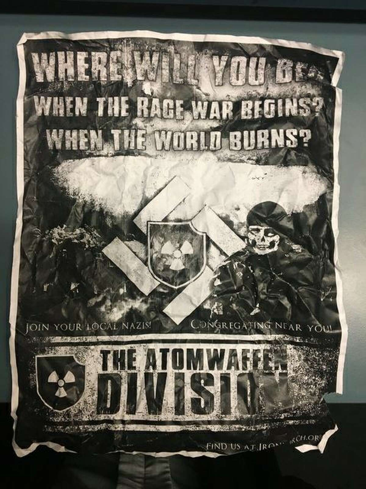 """The cast and crew of University of Washington's production of Shakespeare's """"As You Like It"""" found eight copies of this neo-Nazi poster plastered to the theater's front door Wednesday night during their performance. UW police say similar posters have cropped up throughout campus."""