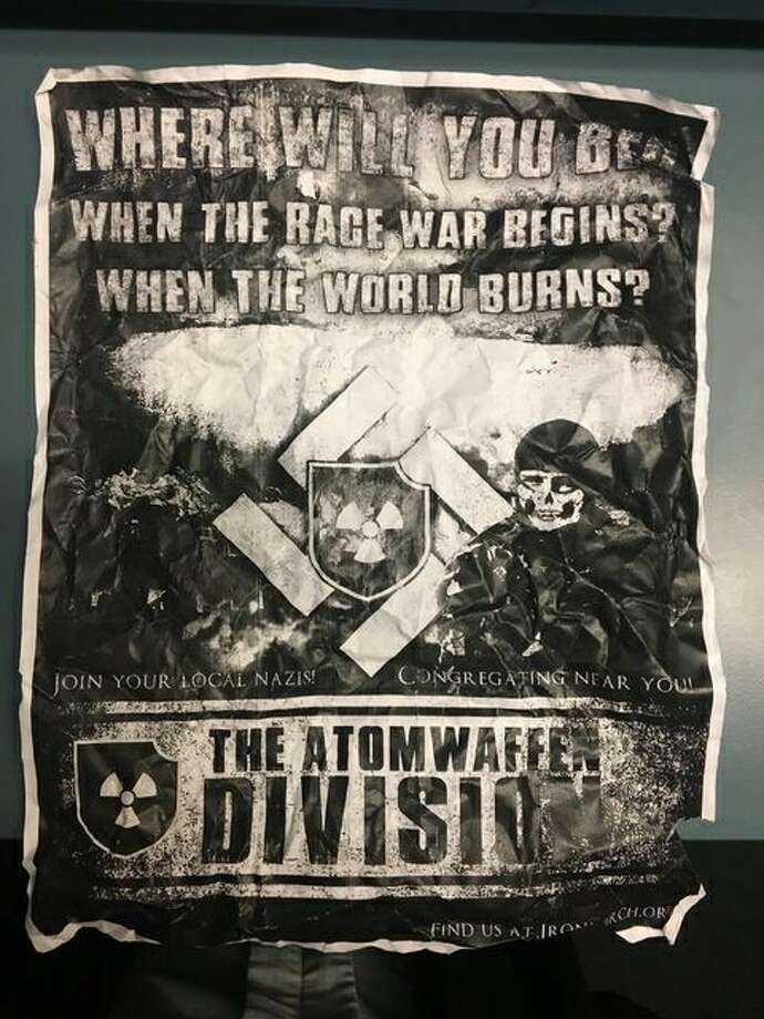 "The cast and crew of University of Washington's production of Shakespeare's ""As You Like It"" found eight copies of this neo-Nazi poster plastered to the theater's front door Wednesday night during their performance. UW police say similar posters have cropped up throughout campus. Photo: Courtesy Tamsen Glaser"