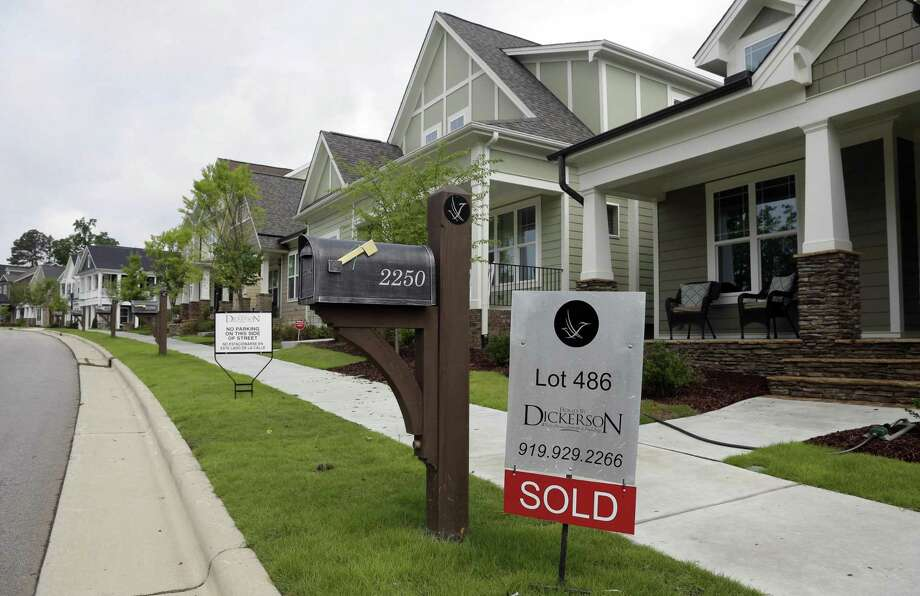 According to Freddie Mac, the 30-year fixed-rate average slipped to 4.15 percent. It was 4.17 percent last week and 3.65 percent a year ago. Photo: Associated Press /File Photo / Copyright 2016 The Associated Press. All rights reserved.