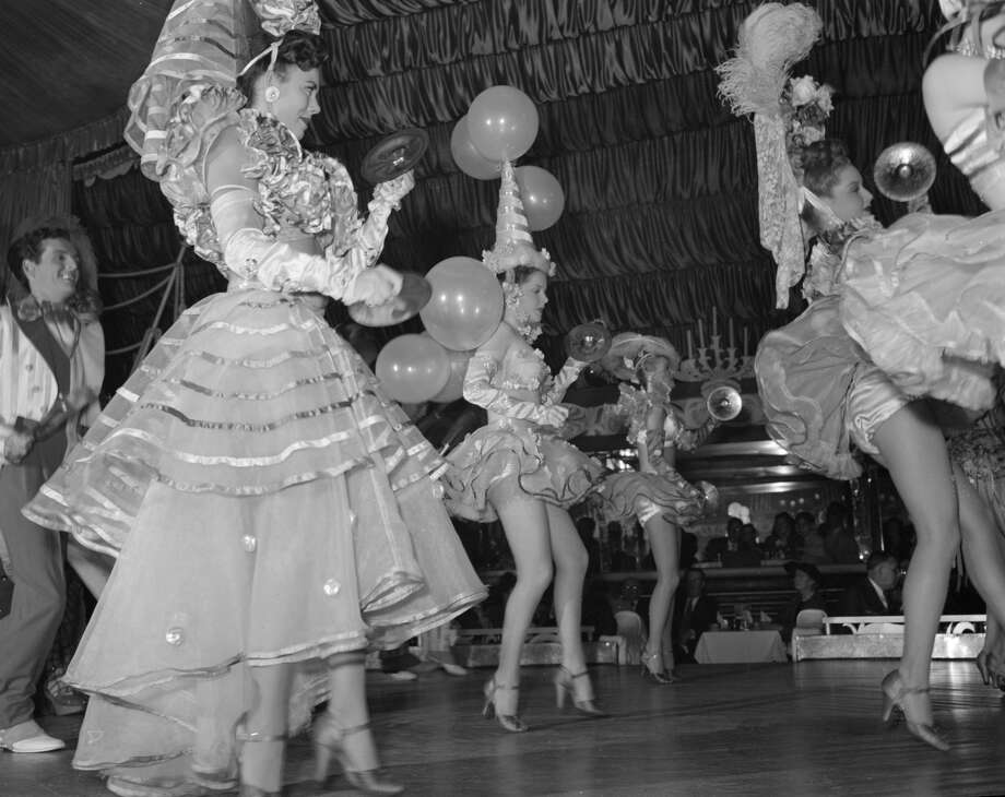 A dance ensemble entertain guests at a masquerade in the Latin Quarter of New Orleans in 1948. Photo: Three Lions/Getty Images